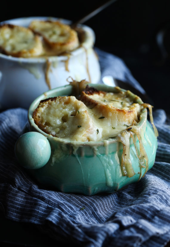 French Onion Soup is loaded with flavor and topped with cheesy bread