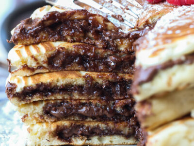Nutella Stuffed Pancakes are an over the top pancake recipe filled with creamy Nutella