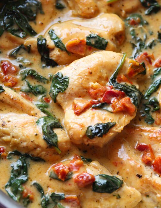 Easy Tuscan Chicken Recipe is made in a cream sauce with spinach and sun dried tomatoes
