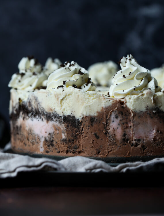 Neapolitan Ice Cream Cake has layers of crushed Oreo Cookies in between each layer