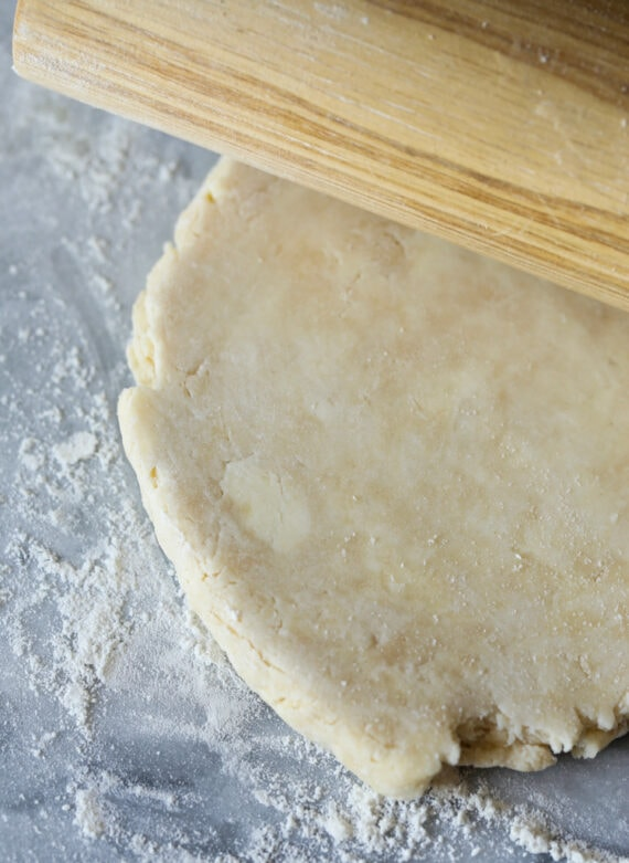 Rolling out pie dough with a rolling pin