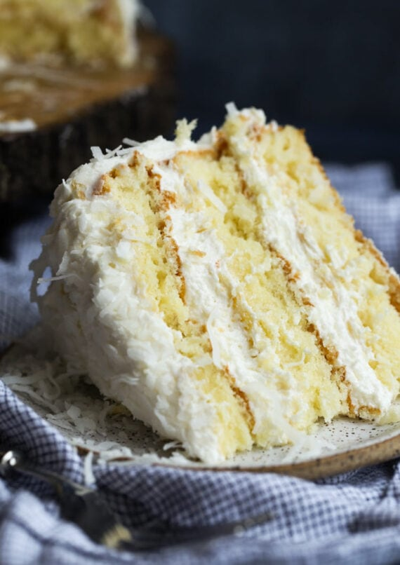 Coconut cake sliced on a plate