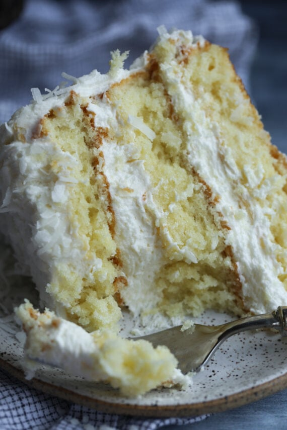Coconut Layer Cake With a Bite Taken Out