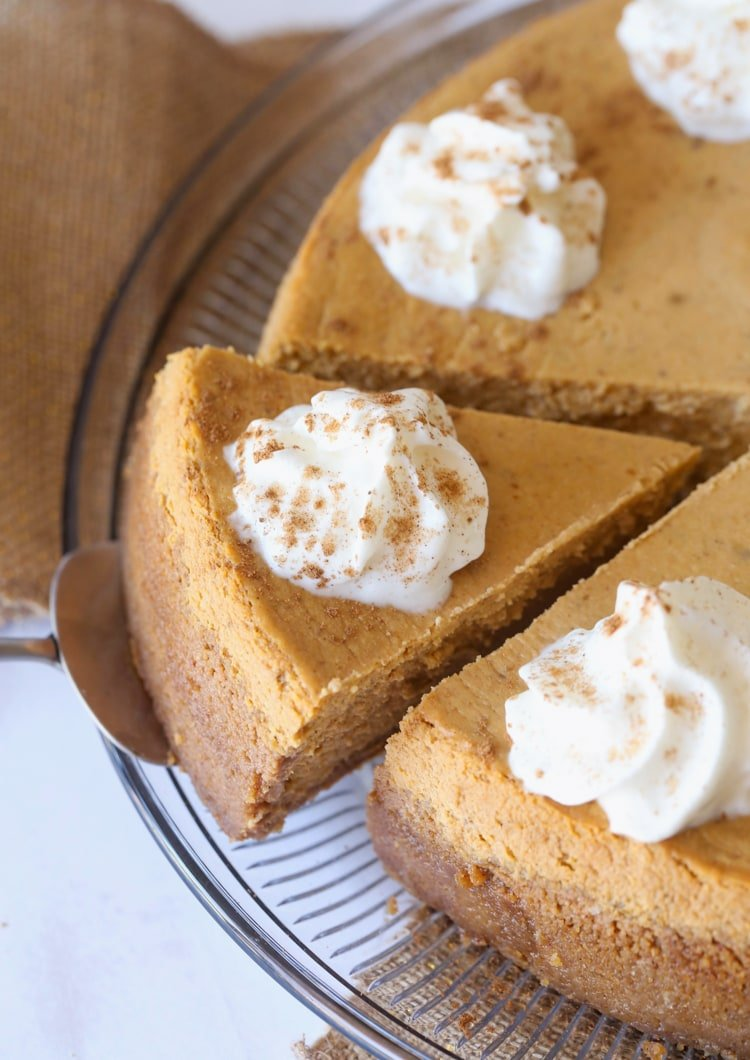 Sliced Pumpkin Cheesecake with whipped cream