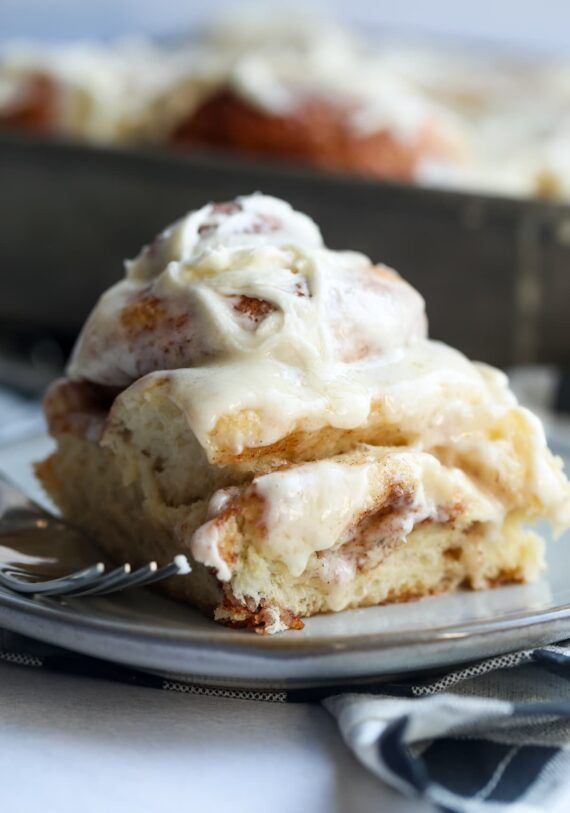 Bakery Style Cinnamon Rolls topped with buttercream frosting