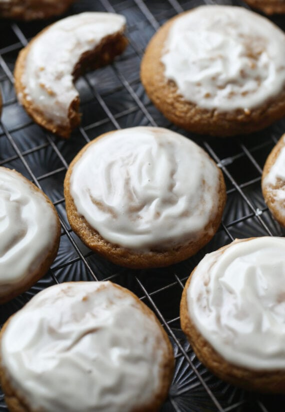 Pumpkin Molasses Cookies with vanilla icing on a cooling rack