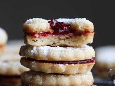 Linzer Cookies Stacked with raspberry preserves
