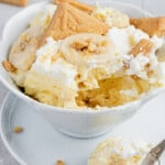 Banana Pudding in a bowl with a bite and spoon taken out