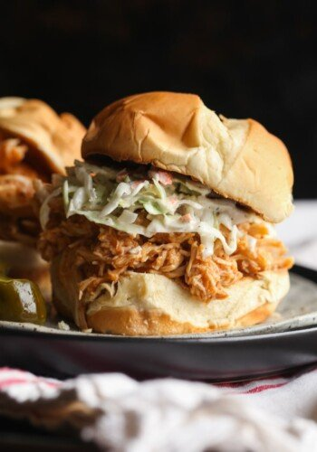 BBQ Pulled Chicken on a bun topped with cole slaw
