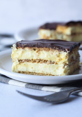 Eclair Cake on a plate with layers of vanilla pudding and graham crackers