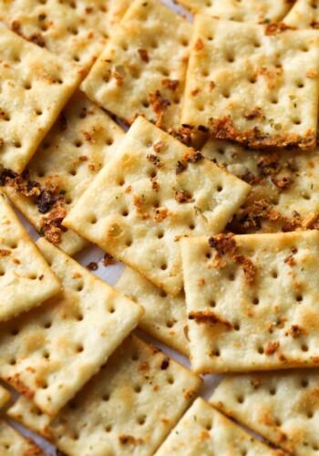 Seasoned Saltines on a baking sheet