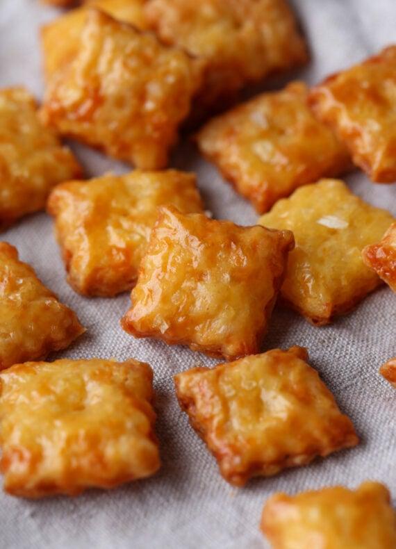 Homemade Cheez Its on a baking sheet
