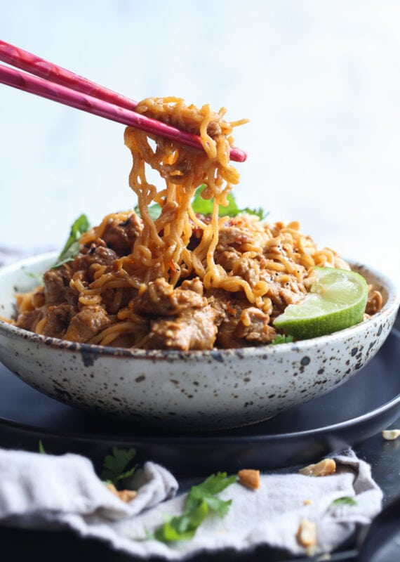Ramen Noodles in homemade sauce in a bowl with chopsticks