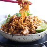 Pork Ramen Noodles in a bowl being eaten