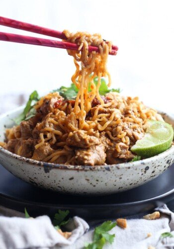 Pork Ramen Noodles in a bowl being eaten