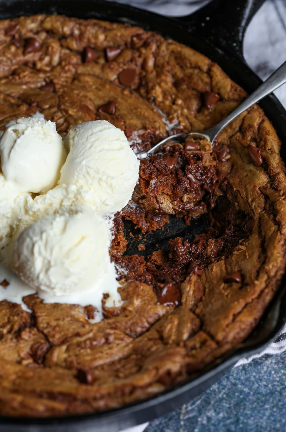 skillet cookie topped with ice cream