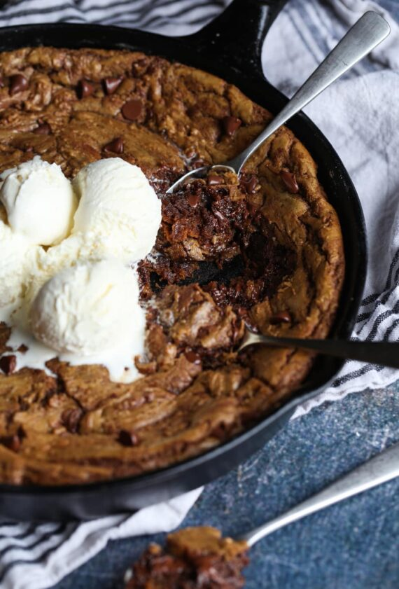 Pizookie Cookie in a skillet with ice cream