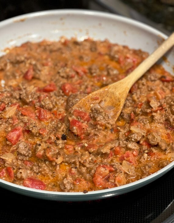 Ground Beef with tomatoes in a skillet