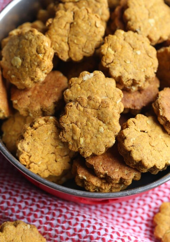 A dog bowl filled to the brim with homemade dog treats.