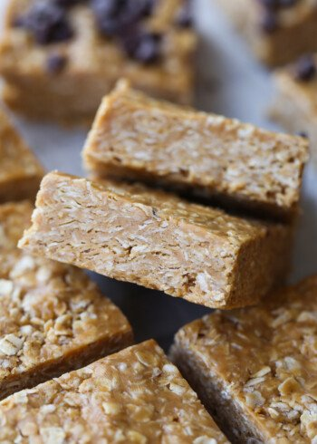 No Bake Oat Squares cut and stacked on parchment paper
