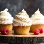 Vanilla cupcakes with toasted frosting and raspberries