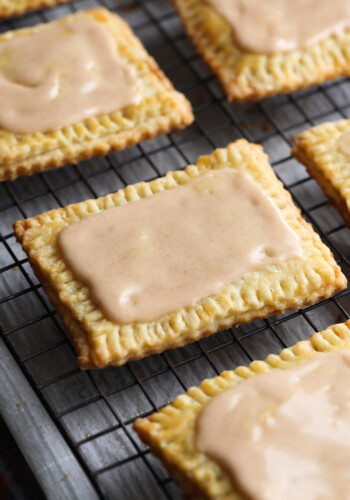 Homemade Pop Tarts covered with icing and cooling on a wire rack