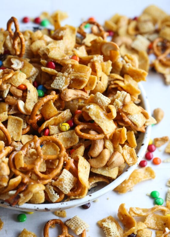 Salty sweet snack mix in a bowl with pretzels, chex and Fritos.