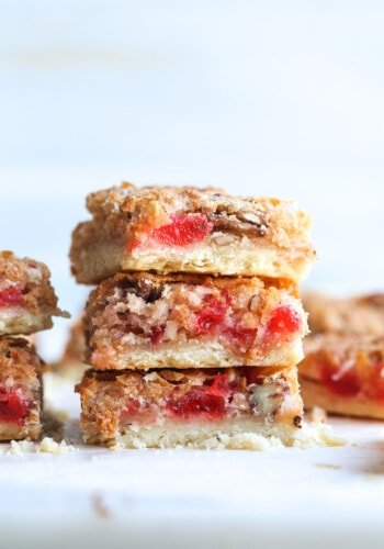 Stacked Cherry Coconut Bars with shortbread crust