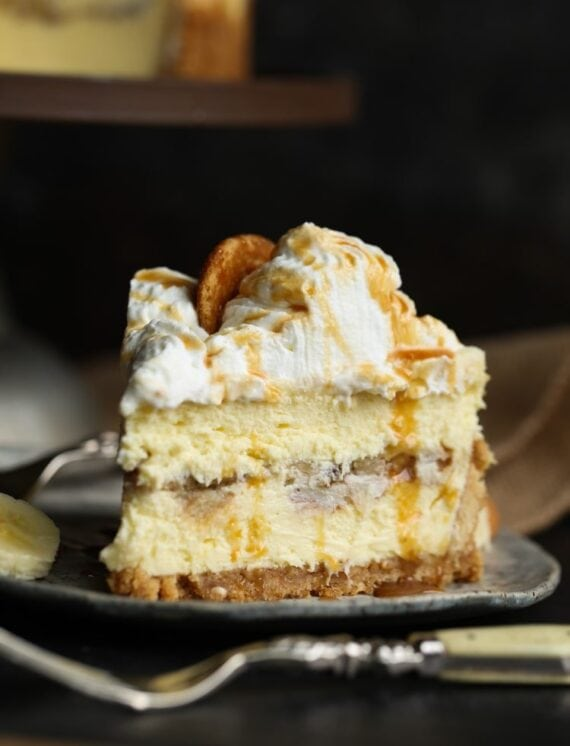Slice of banana pudding cheesecake on a plate.