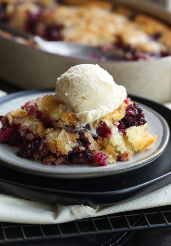 Backberry Cobbler on a plate with ice cream