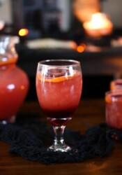 Blood Orange Punch garnished with a sliced blood orange in a goblet