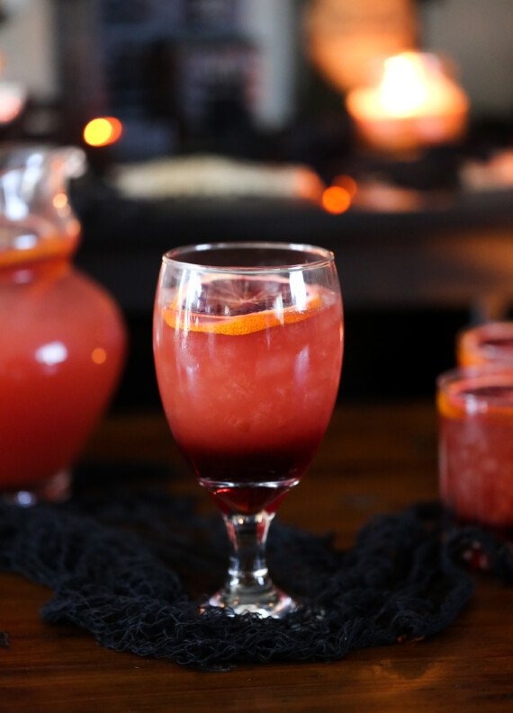 Blood Orange Punch garnished with a sliced blood orange in a  goblet