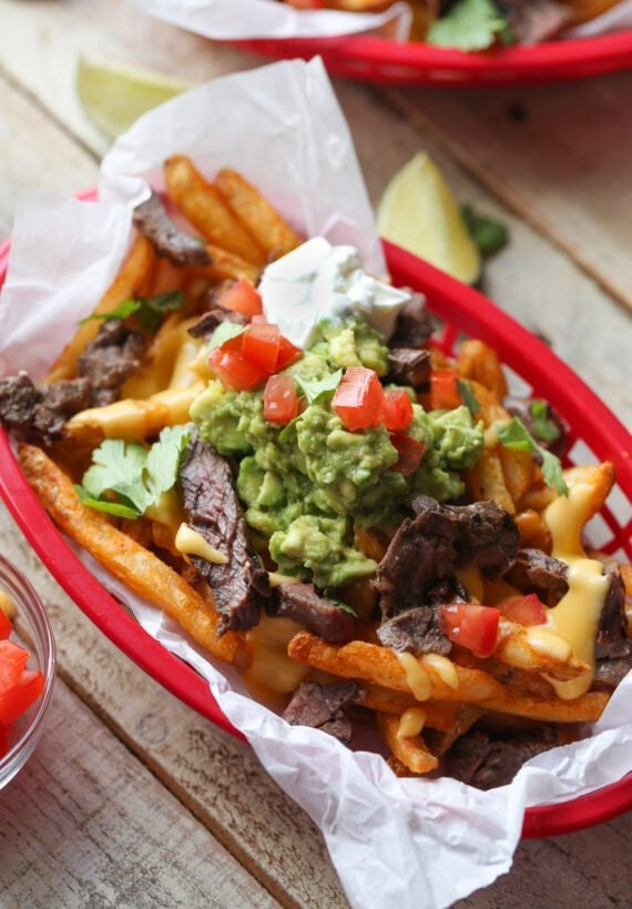 Loaded tex mex french fries with cheese, guacamole, and steak