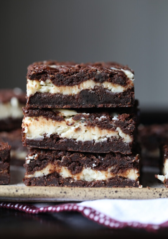 A Close-up of Three Cheesecake Stuffed Brownies From the Side