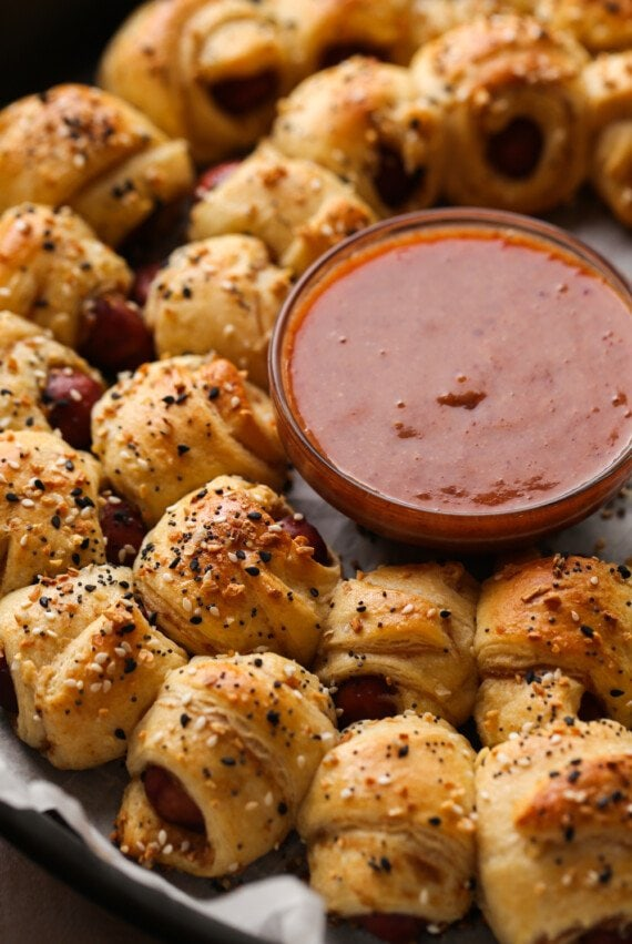 Pigs In a Blanket topped with everything seasoning and dipping sauce