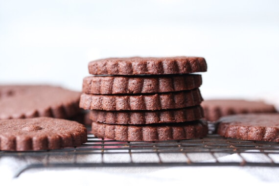 A Stack of Chocolate Sugar Cookies With Ridges Around the Edges