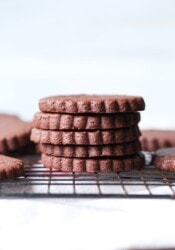 A Pile of Five Chocolate Sugar Cookies Sitting on a Cooling Rack