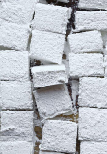 A Bunch of Square Homemade Marshmallows on a Wooden Surface