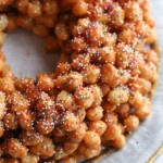 A Struffoli Fried Dough Wreath on a Serving Plate as Seen From Above