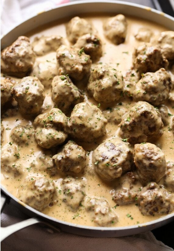 Swedish meatballs with gravy in a pan.
