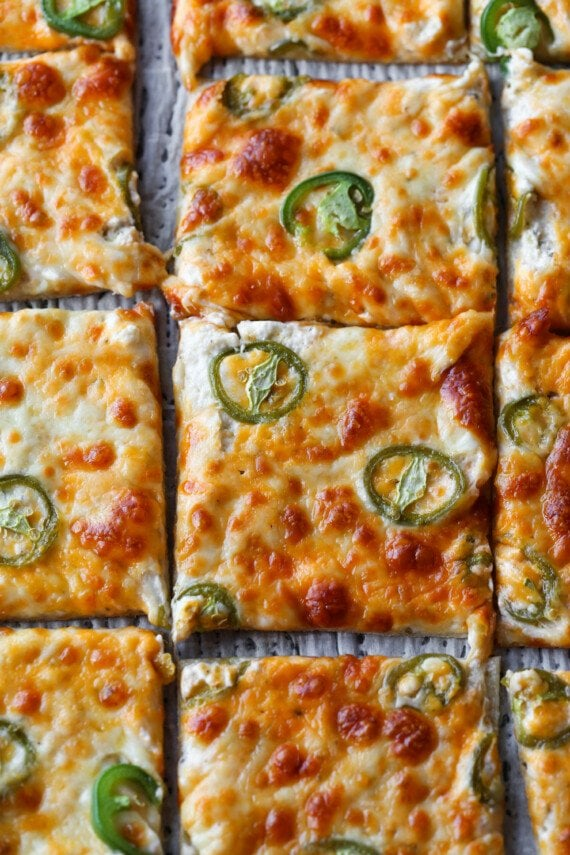 Jalapeno Popper Pizza sliced on a tray