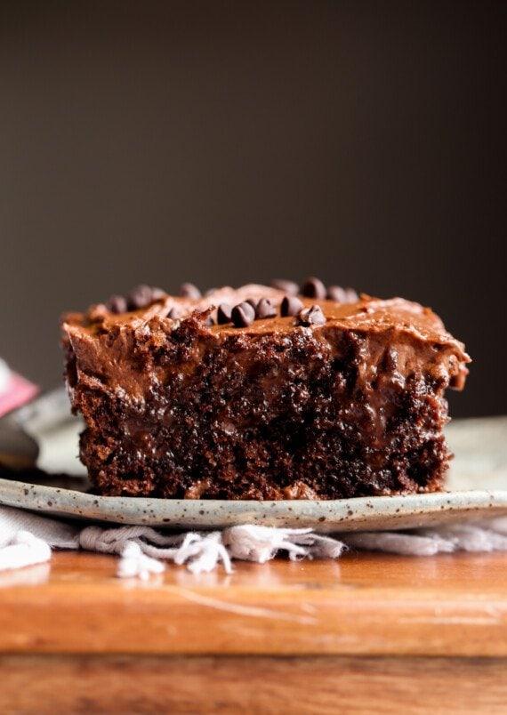Chocolate Poke Cake sliced on a plate