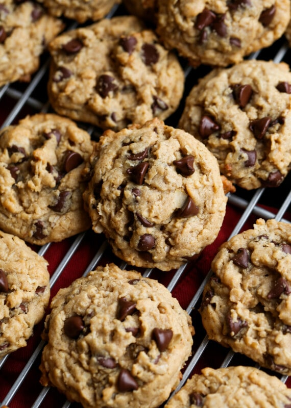 Peanut butter oatmeal cookies with chocolate chips on a cooling rack from above