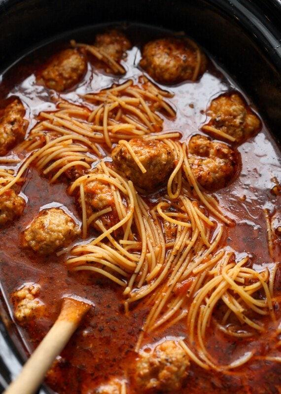 Spaghetti and meatballs in a tomato soup in a crock pot