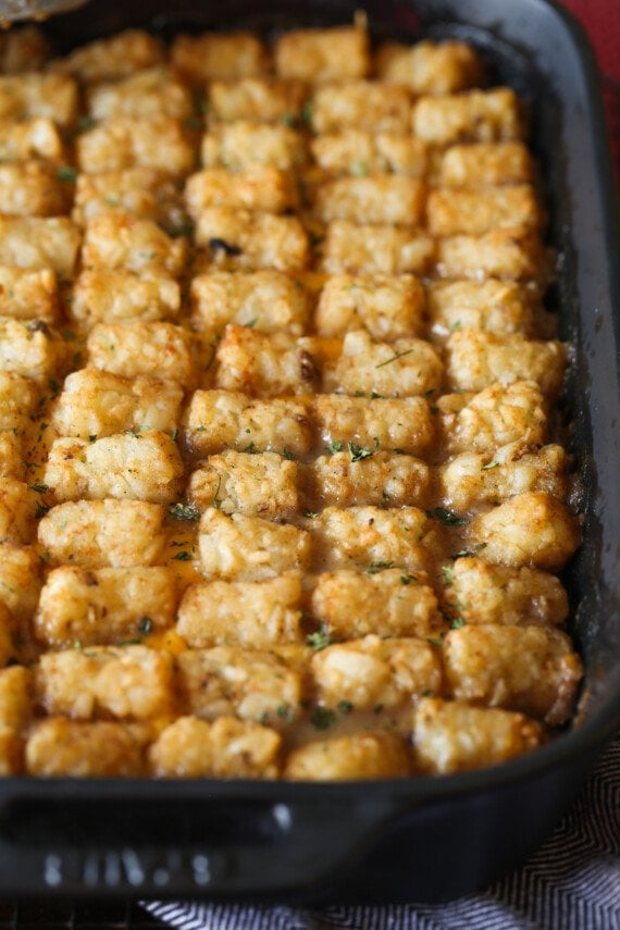 Tater tot casserole in a 9x13 pan.