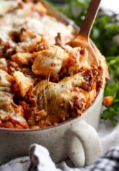 Unstuffed Shells pasta casserole with a spoon and melty cheese