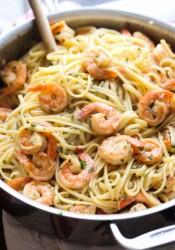 Pan full of shrimp and linguine.