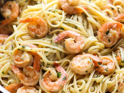 Pan full of shrimp and linguine.
