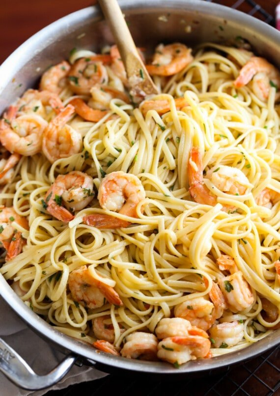 Shrimp scampi in a pan with linguine.