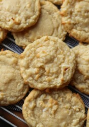 Coconut Cookies piled on a wire cooling rack